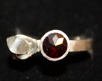 Silver ring with granat