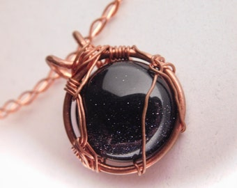 One Blue Goldstone Copper Wire Wrapped Pendant