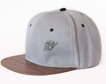 Handmade snapback hat with wooden brim and logo