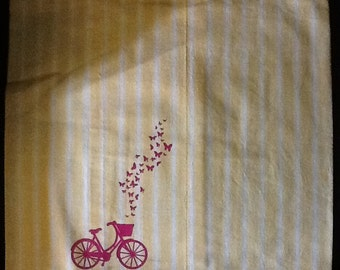 Yellow stripe pillow with bike print