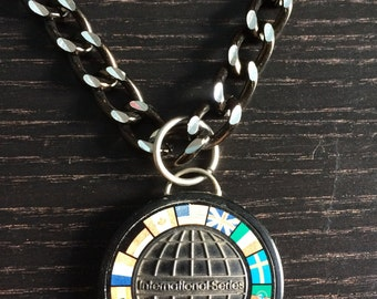 Saab international emblem necklace with black and silver chain