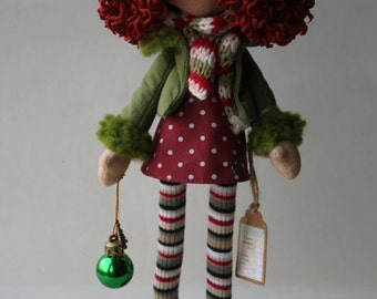 Doll in a pea-green dress