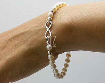 Freshwater Cultured Pearl infinity Bracelet featuring a  Sterling Silver Charm intertwined with Sterling Silver Beads and a S/S Magnet Clasp