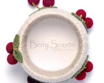 Crochet cherry light-colored bracelet