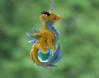 Yellow dragon pendant
