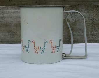 Vintage metal flour sifter with duck pattern