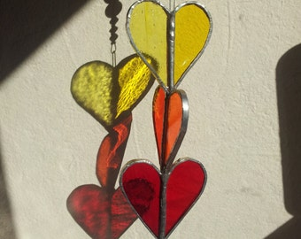 Stained Glass Triple Heart Sun Catcher in Reds,Oranges, and Yellows with Glass Beads