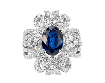 18k White Gold With Diamonds and blue sapphire, size 6.5