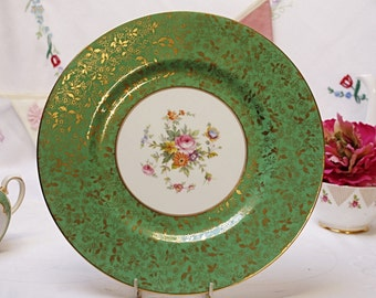 A Beautiful Minton  Brocade  plate: In a beautiful shade of green, exquisite gold brocade and floral centre . Perfect for display or to use.