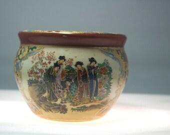 Asian family cylindrical shaped porcelain jar.