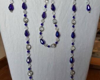Blue/Purple jewelry ensemble includes necklace, bracelet and earrings