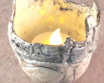 Unique handmade tealight or ring holder created from high-fired porcelain with underglaze decoration and lustre detail.