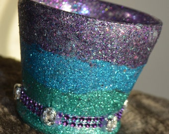 Purple, blue, and teal candle holder