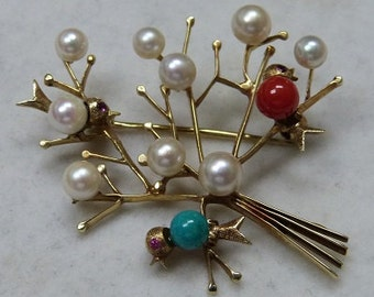 14 karat gold German made avian motif brooch