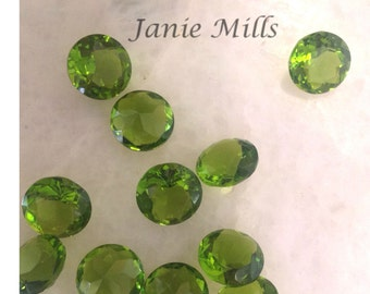 Peridot faceted gemstone 10 mm round