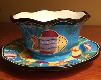 Set of 4 beach-themed bowls and plates