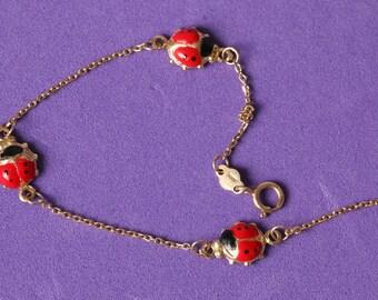 GIRLS bracelet gold enamel sprockets