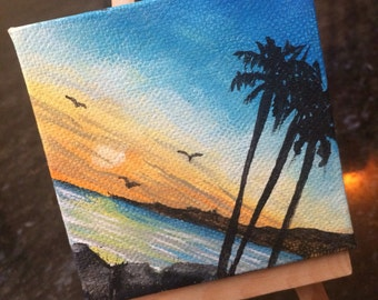 Small canvas painting with wooden stand.
