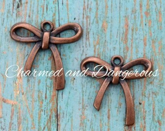10 Copper Bow charms (CM246)