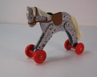 Dapple grey horse on wheels