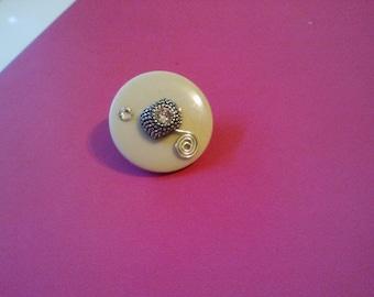 Button swirl broach