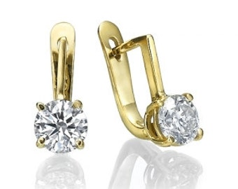 14K gold earrings.  2.32 gr. Diamond Center: 1.64 CT