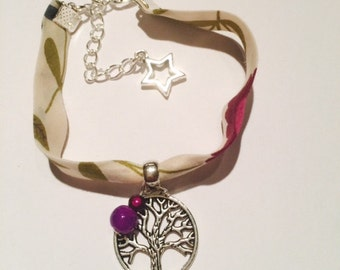 Liberty tree of life with purple beads bracelet.