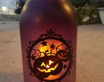 Halloween quart size jar, tinted in a purple haze with a battery operated tea light
