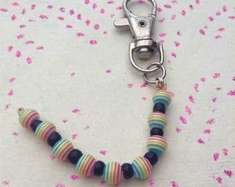 Pink and black rainbow glass beaded key ring / key chain.