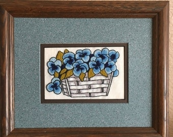 Embroidered framed forget me not wall hanging