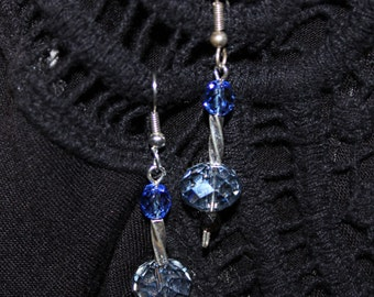 Light blue and silver tone wire crystal earrings