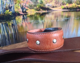 30.  Brown bracelet with studs