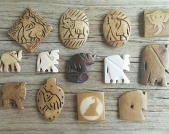 13 Carved Bone Elephant Beads