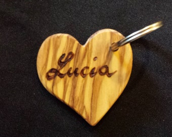 KEY RING heart shaped olive wood, personalized with name carved in focus