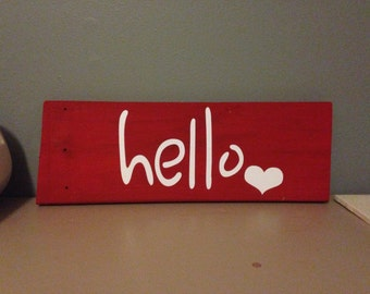 Handpainted red and white wooden hello sign