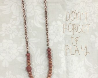 Copper and gold beaded necklace with  cupcake charm and antique copper chain