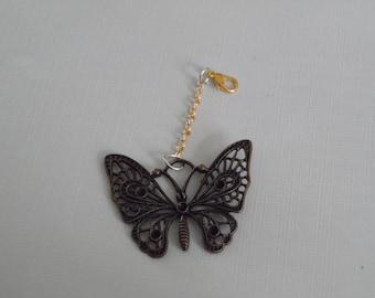 Bronze butterfly charm