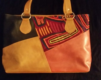 Leather handbag, stiched fabric