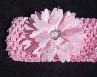 Soft stretchy headband with flower and rhinestones