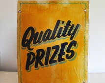 Fairground sign. Hand painted, Quality Prizes. Yellow and black paint on board panel. Collectable.