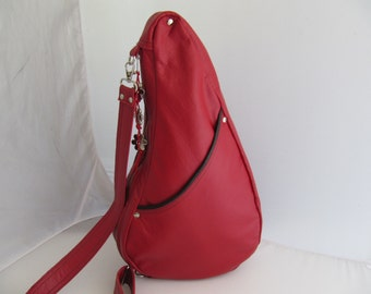 Red leather cross body backpack