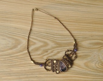 Handmade macrame necklace with amethyst stone