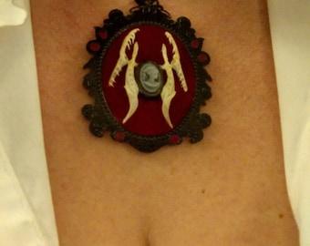 Taxidermy jewelry, fanged cameo