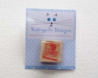 Italian postage stamp brooch.
