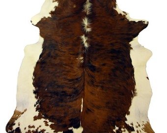 Brown and white exotic white belly cow hide