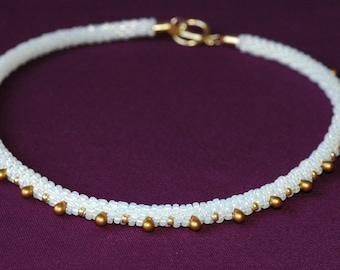 Beaded ivory gold kumihimo necklace