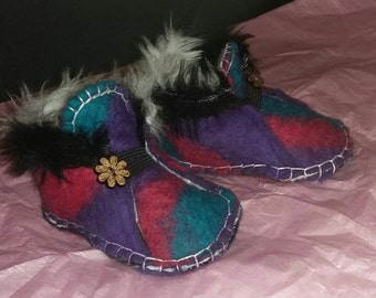 Beautiful hand felted, stitched and fur lined baby booties