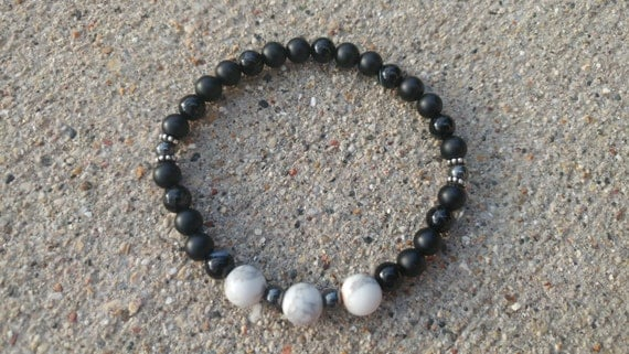 Black as Night. For insomnia and grounding purposes. Matte and polished black Onyx, Howlite, Hematite with spacers and stretch string.