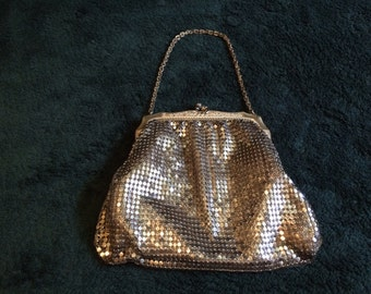 Small vintage purse made by Whiting & Davis. Gold collection.