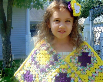 poncho and big flower hair clip